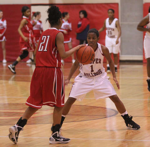 Julia Land plays defense against Diboll. Photo: Jason Dunn