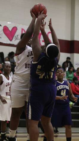 Delicia Rushing puts up a short shot in the paint. Photo: Jason Dunn