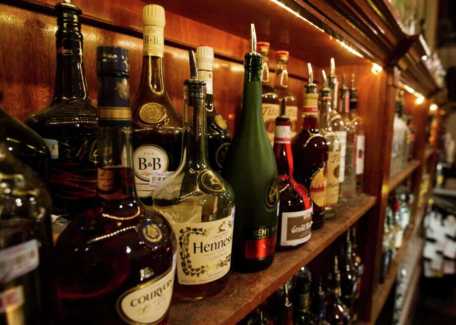 Premium liquors are ready to be served at the Marfreless bar in River Oaks on Wednesday, Nov. 7, 2012, in Houston. ( J. Patric Schneider / For the Chronicle ) Photo: J. Patric Schneider, Freelance / © 2012 Houston Chronicle