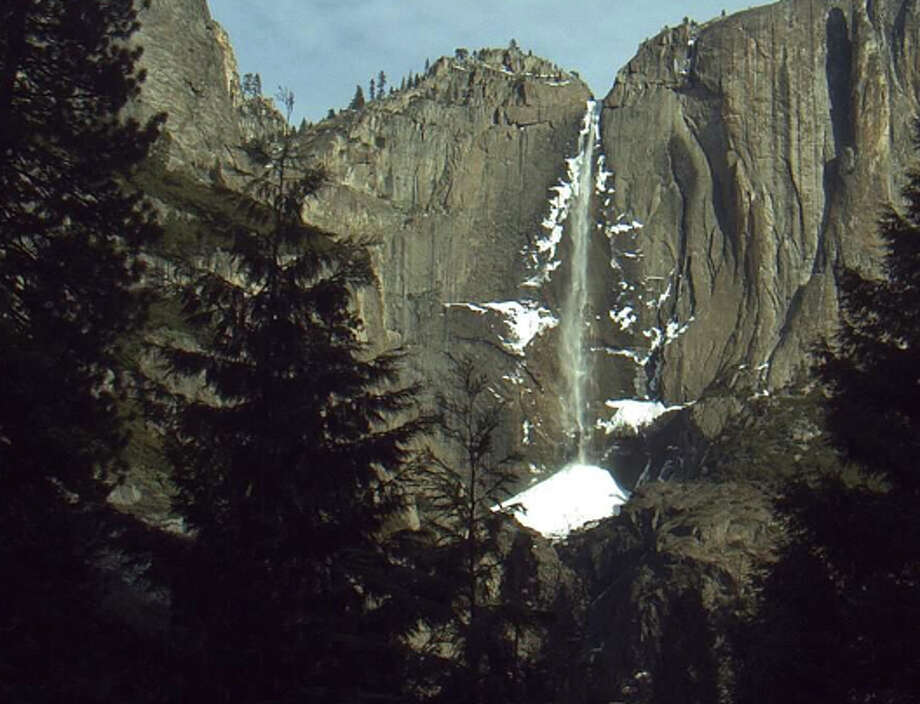 As sunlight first cast over Yosemite Valley Tuesday morning, Yosemite Falls was a frozen wisp