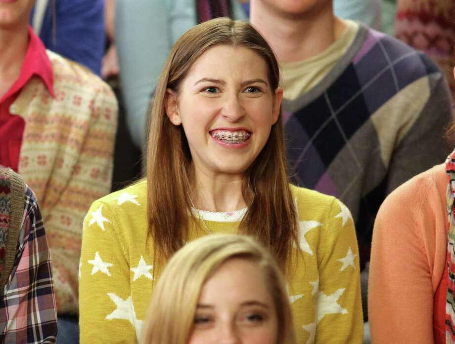 "This undated publicity image released by ABC shows actress Eden Sher as Sue Heck in a scene from the comedy series ""The Middle,"" airing Wednesday at 8 p.m. EST on ABC. Sher wore a set of removable braces to her audition to play the daughter on the ABC comedy, helping her win the job. They're the signature of the geeky, loveable loser that is high school soph Sue Heck. (AP Photo/ABC, Michael Ansell) Photo: Michael Ansell, Associated Press / American Broadcasting Companies,"