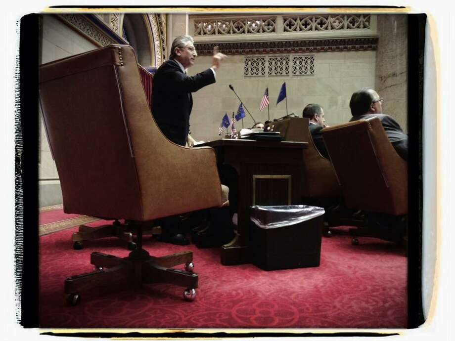 Assemblyman Jim Tedisco rises to speak against the state's gun legislation on the floor of the Assembly on Jan. 15, 2013. (Paul Buckowski/Times Union)