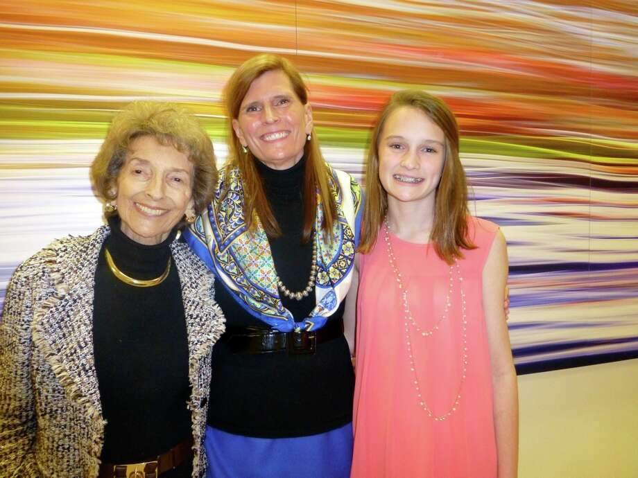 "Aubrey Carter (from left), Allison Hays Lane, creator of ""Salud-Arte: Art of Healing"" for the Robert B. Green Clinical Pavilion, and Anna Lane attend the clinic's dedication reception. Photo: Nancy Cook-Monroe, For The Express-News"