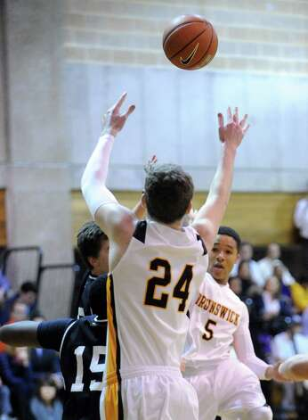 Teddy Murphy # 24 of Brunswick goes up high for a pass from teammate Henry Taylo during boys high school basketball game between Brunswick School and St. Luke's at Brunswick in Greenwich, Friday night, Jan., 11, 2013. Photo: Bob Luckey / Greenwich Time