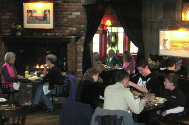 Quiet, fireside dining is among the attractions of the Fife'n Drum Restaurant in Kent as it celebrates its 40th anniversary, Jan. 20, 2013 Photo: Norm Cummings