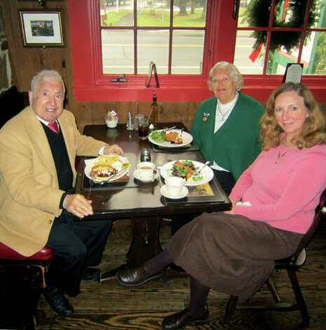 Owners Dolph and Audrey Traymon share a Sunday dinner with friend Lisa Cruse at the Fife'n Drum Restaurant in Kent. Jan. 13, 2013 Photo: Norm Cummings