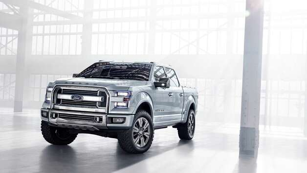 FORD ATLAS CONCEPT: Ford is trying to keep its rivals at bay with a concept that hints at the look of the next F-Series pickup. The Atlas has a chiseled design and a bigger, more elaborate grille. Ford is emphasizing fuel economy. The Atlas has shutters on the grille and wheels that close automatically, improving aerodynamics. The new truck also will weigh several hundred pounds less than the current model and have a more efficient engine. Ford won't say when the new truck goes on sale, but it's likely to be a 2015 model.More photos of the Atlas concept Photo: Ford Motor Company