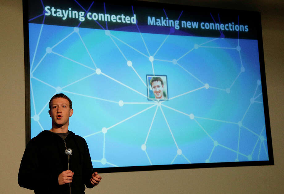 Facebook CEO Mark Zuckerberg speaks about Facebook Graph Search at a Facebook headquarters in Menlo Park, Calif., Tuesday, Jan. 15, 2013.  The new service lets users search their social connections for information about their friends' interests, and for photos and places.  (AP Photo/Jeff Chiu) Photo: Jeff Chiu, Associated Press / AP