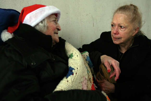 Ann Marie Tarinelli, right, of Trumbull, seen here in December of 2008, speaks with Jennie Sforza during her regular meal for the homeless and underprivileged under the Route 25 overpass on John Street in Bridgeport, Conn. Tarinelli, who prepared and served meals at the location for many years, passed away last Friday. She was 75. Photo: Brian A. Pounds / Connecticut Post