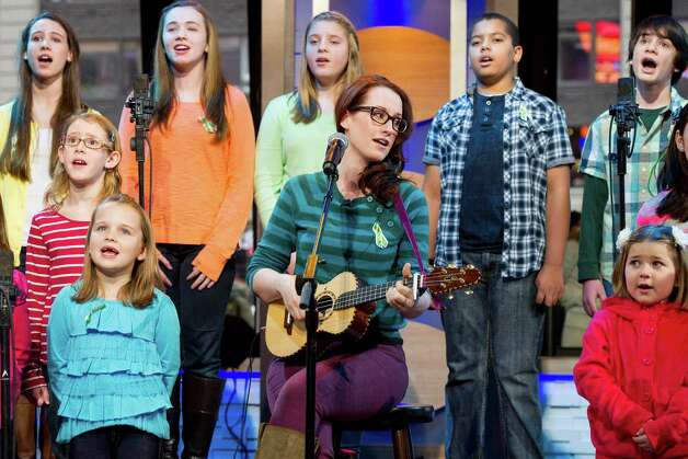 "Ingrid Michaelson accompanied by children from Newtown, Conn. and Sandy Hook Elementary school perform ""Somewhere Over the Rainbow"" on ABC's ""Good Morning America"" on Tuesday, Jan. 15, 2013 in New York. (Photo by Charles Sykes/Invision/AP) Photo: Charles Sykes, Associated Press / Associated Press"