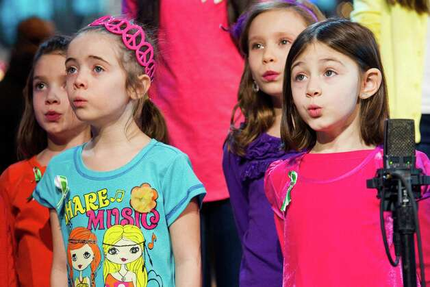 "Children from Newtown, Conn. and Sandy Hook Elementary school perform ""Somewhere Over the Rainbow"" on ABC's ""Good Morning America"" on Tuesday, Jan. 15, 2013 in New York. (Photo by Charles Sykes/Invision/AP) Photo: Charles Sykes, Associated Press / Associated Press"