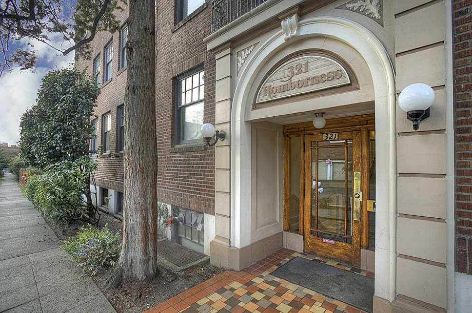 Entrance of 321 Boylston Ave. E. The 589-square-foot third-floor corner unit, built in 1925, has one bedroom, an updated kitchen and bathroom, original fixtures, moldings, radiators and double-hung windows, and a washer and dryer. It's listed for $245,000. Photo: Gregory White, Courtesy Diane Lancaster/Windermere Real Estate / (C) 2012 Gregory White