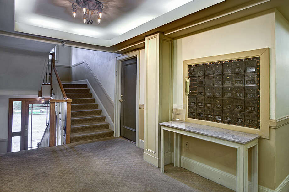 Lobby of 321 Boylston Ave. E. The 589-square-foot third-floor corner unit, built in 1925, has one bedroom, an updated kitchen and bathroom, original fixtures, moldings, radiators and double-hung windows, and a washer and dryer. It's listed for $245,000. Photo: Gregory White, Courtesy Diane Lancaster/Windermere Real Estate / (C) 2012 Gregory White