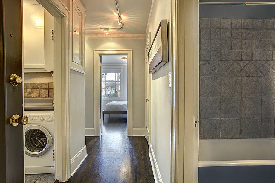 Hallway of 321 Boylston Ave. E., No. 307. The 589-square-foot third-floor corner unit, built in 1925, has one bedroom, an updated kitchen and bathroom, original fixtures, moldings, radiators and double-hung windows, and a washer and dryer. It's listed for $245,000. Photo: Gregory White, Courtesy Diane Lancaster/Windermere Real Estate / (C) 2012 Gregory White