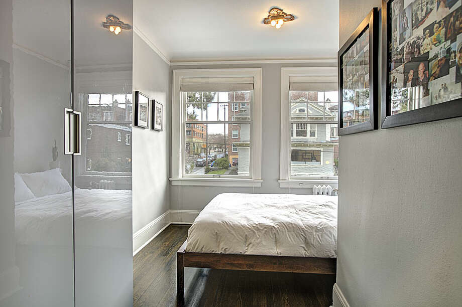 Bedroom of 321 Boylston Ave. E., No. 307. The 589-square-foot third-floor corner unit, built in 1925, has one bedroom, an updated kitchen and bathroom, original fixtures, moldings, radiators and double-hung windows, and a washer and dryer. It's listed for $245,000. Photo: Gregory White, Courtesy Diane Lancaster/Windermere Real Estate / (C) 2012 Gregory White