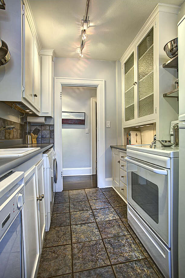 Updated kitchen of 321 Boylston Ave. E., No. 307. The 589-square-foot third-floor corner unit, built in 1925, has one bedroom, an updated bathroom, original fixtures, moldings, radiators and double-hung windows, and a washer and dryer. It's listed for $245,000. Photo: Gregory White, Courtesy Diane Lancaster/Windermere Real Estate / (C) 2012 Gregory White