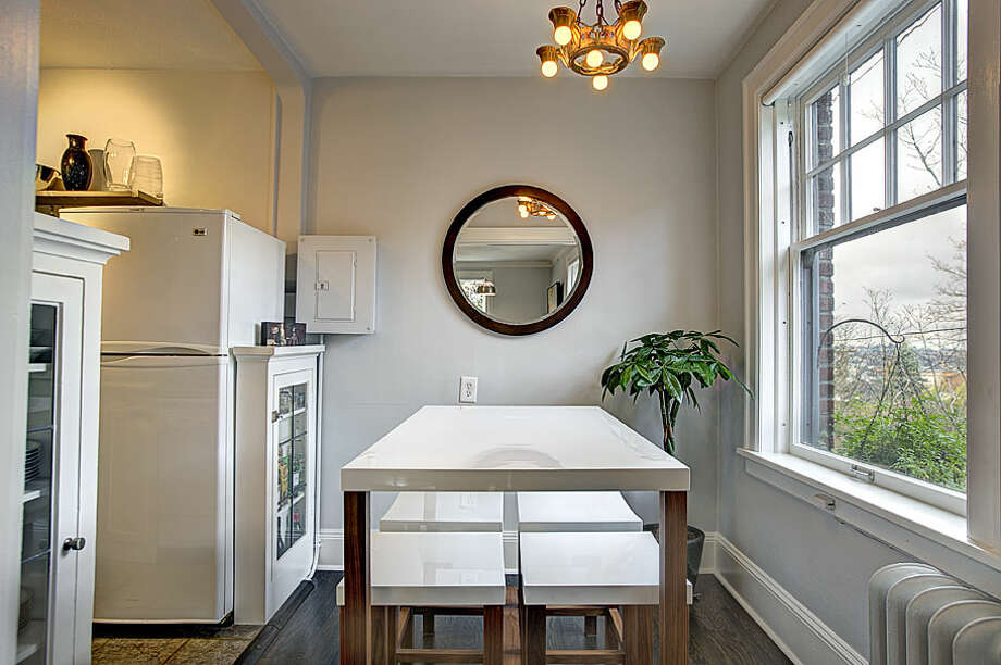 Dining area of 321 Boylston Ave. E., No. 307. The 589-square-foot third-floor corner unit, built in 1925, has one bedroom, an updated kitchen and bathroom, original fixtures, moldings, radiators and double-hung windows, and a washer and dryer. It's listed for $245,000. Photo: Gregory White, Courtesy Diane Lancaster/Windermere Real Estate / (C) 2012 Gregory White