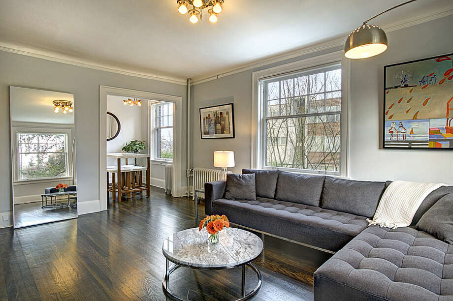 Living room of 321 Boylston Ave. E., No. 307. The 589-square-foot third-floor corner unit, built in 1925, has one bedroom, an updated kitchen and bathroom, original fixtures, moldings, radiators and double-hung windows, and a washer and dryer. It's listed for $245,000. Photo: Gregory White, Courtesy Diane Lancaster/Windermere Real Estate / (C) 2012 Gregory White