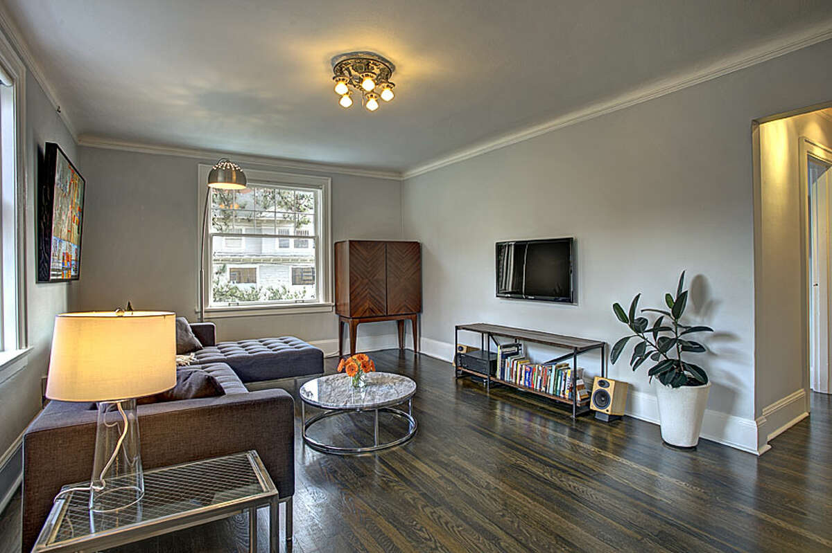 Living room of 321 Boylston Ave. E., No. 307. The 589-square-foot third-floor corner unit, built in 1925, has one bedroom, an updated kitchen and bathroom, original fixtures, moldings, radiators and double-hung windows, and a washer and dryer. It's listed for $245,000.