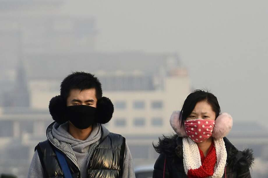 Welcome to Beijing. Breathe at your own risk:Shares in a Chinese face mask manufacturer soared Monday as severe air pollution blanketed the capital and large swathes of China for a fourth straight day. The American Embassy reported a morning Air Quality Index of 406. Anything above 300 is considered hazardous. Photo: Wang Zhao, AFP/Getty Images