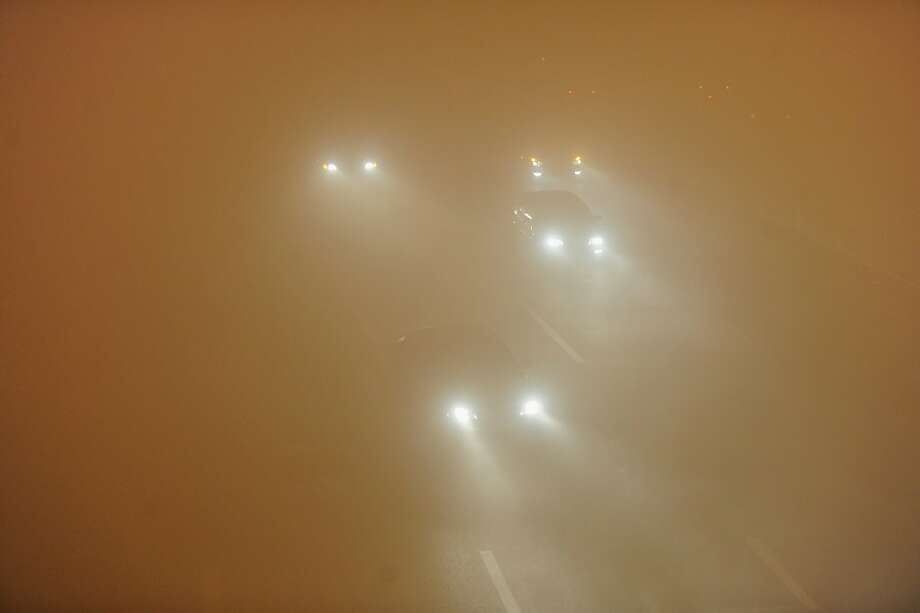 I can't see for miles and miles and miles and … Driving in China's record air pollution is particularly challenging. (Highway in Hefei.) Photo: Stringer, AFP/Getty Images