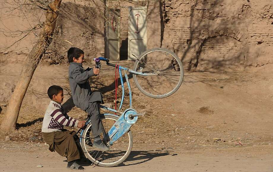 How to tell if your child is overweight?Actually, these two are just perfecting their wheelie on a dirt street in Herat. Photo: Aref Karimi, AFP/Getty Images