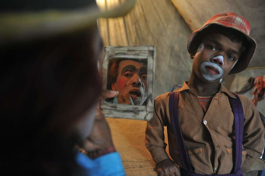 The future of clowning: Madhusudan Ghosh, a 63-year-old clown, applies makeup as her son, Gourango, 19, watches in their tent at Kohinoor Circus in Siliguri, India. There are 10 circuses operating in India, down from about 50 in the mid-1900s. Photo: Diptendu Dutta, AFP/Getty Images