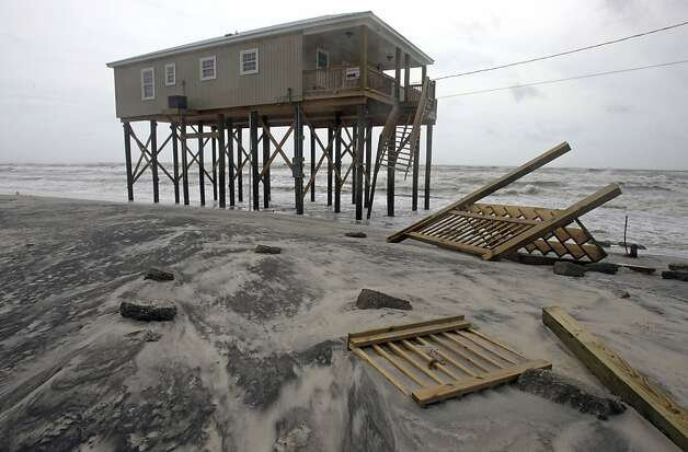The staircase for a home now lies smashed in the sands in front of the structure Thursday, Aug. 30, 2012 on Dauphin Island, Ala. after Hurricane Isaac's landfall in Louisiana. (AP Photo/Press-Register, G.M. Andrews) Photo: G.m. Andrews, Associated Press