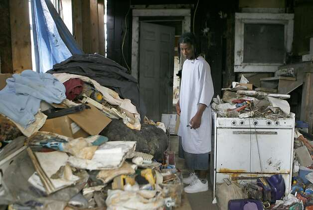 "Corey Morgan, 16, is in what remains of his home in the Lower Ninth Ward in New Orleans. According to his brother, Tim Andrew, 28, since Katrina, their mother ""does a lot of socializing with the invisible."" In New Orleans, depression reigns, suicide rate in the area is triple what it was before Katrina, mental hospitals are closed and there are not enough mental health professionals to handle the need for counseling. Photographed in New Orleans on 8/15/06. (Deanne Fitzmaurice/ The Chronicle)  Photo: Deanne Fitzmaurice, SFC"