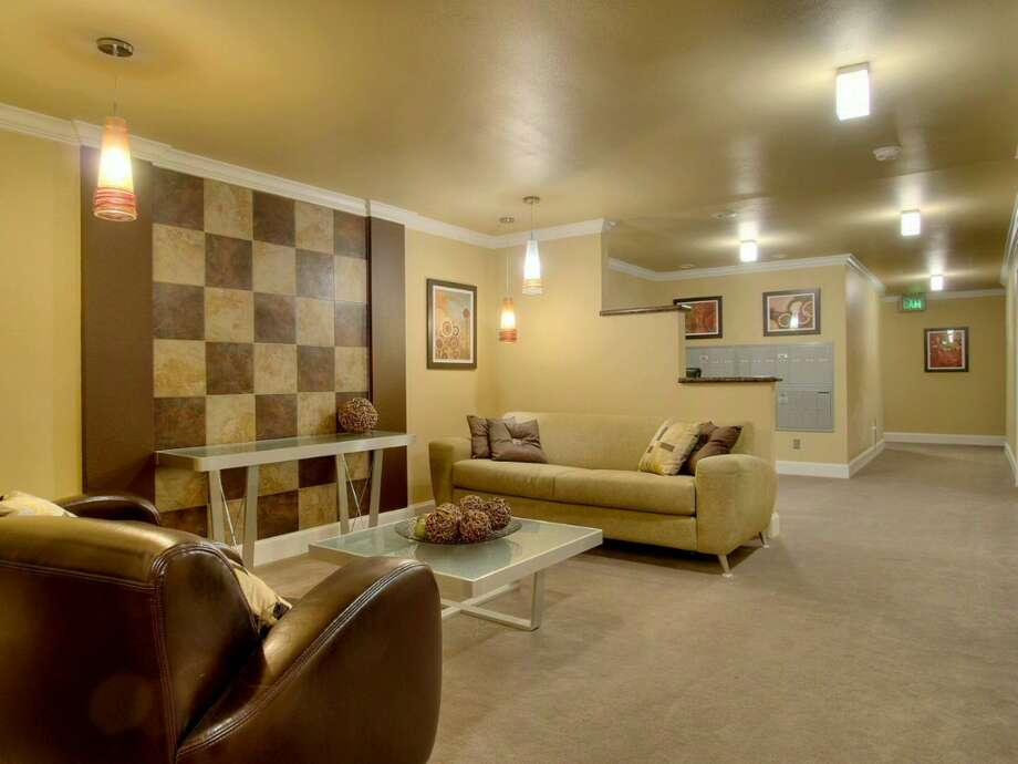 Lobby of 705 E Republican St. The 632-square-foot top-floor corner unit, in a 1963 building, has one bedroom, an updated bathroom and kitchen, bamboo floors, a balcony, a washer and dryer, reserved parking for two cars and access to a community rooftop terrace. It's listed for $249,950, although a sale is pending. Photo: Courtesy Thomas Root/Prudential Northwest Realty Associates.