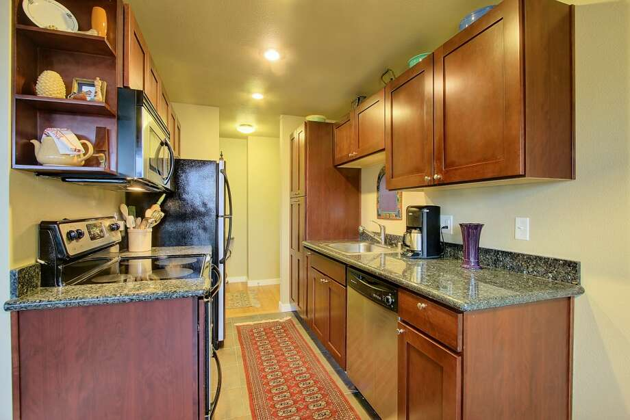 Updated kitchen of 705 E Republican St., No. 508. The 632-square-foot top-floor corner unit, in a 1963 building, has one bedroom, an updated bathroom, bamboo floors, a balcony, a washer and dryer, reserved parking for two cars and access to a community rooftop terrace. It's listed for $249,950, although a sale is pending. Photo: Courtesy Thomas Root/Prudential Northwest Realty Associates.