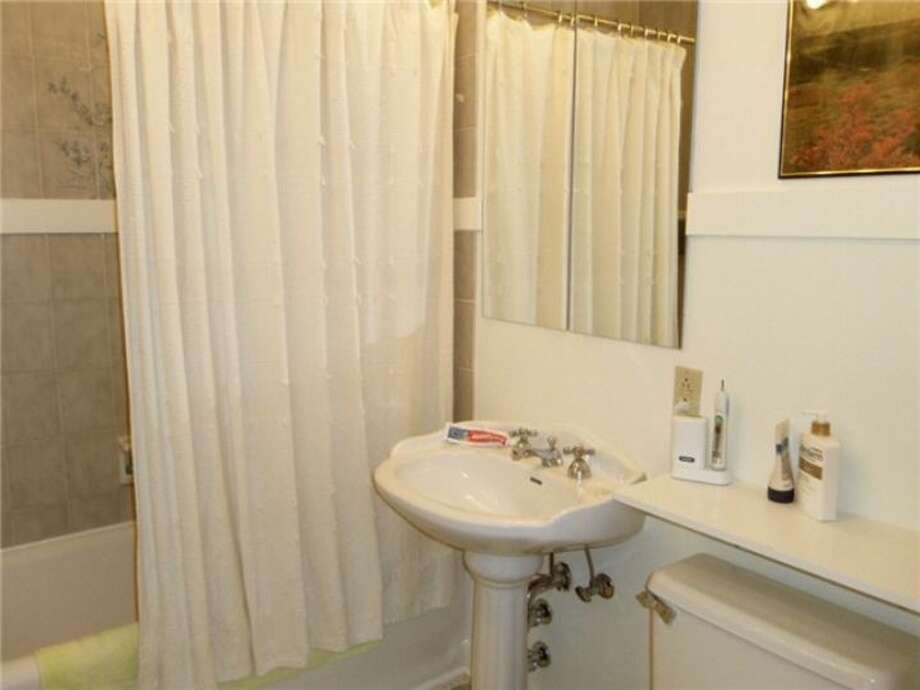 Bathroom of 1605 E. Olive St., No. 309. The one-bedroom condo, in a 1926 building, has an updated kitchen, coved ceilings, original doorknobs and crown moldings and access to a community patio. It's listed at $210,000, although a sale is pending. Photo: Courtesy Linda Juliano/Windermere Real Estate