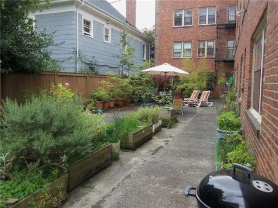 Community patio of 1605 E. Olive St. The one-bedroom condo, in a 1926 building, has an updated bathroom and kitchen, coved ceilings, and original doorknobs and crown moldings. It's listed at $210,000, although a sale is pending. Photo: Courtesy Linda Juliano/Windermere Real Estate