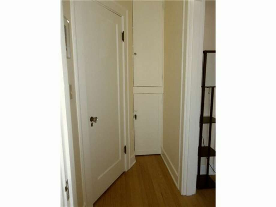 Doorway of 1605 E. Olive St., No. 309. The one-bedroom condo, in a 1926 building, has an updated bathroom and kitchen, coved ceilings, original doorknobs and crown moldings and access to a community patio. It's listed at $210,000, although a sale is pending. Photo: Courtesy Linda Juliano/Windermere Real Estate