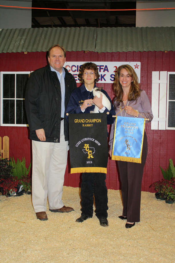Ben Burdett's rabbit was named grand champion in 2012, earning Burdett a check of $1,750.00. Photo: Courtesy