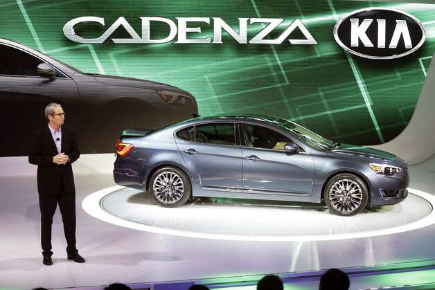 Kia Executive for Sales Tom Loveless, stands by the automaker's Cadenza after is unveiling at the North American International Auto Show in Detroit, Tuesday, Jan. 15, 2013. Photo: Carlos Osorio