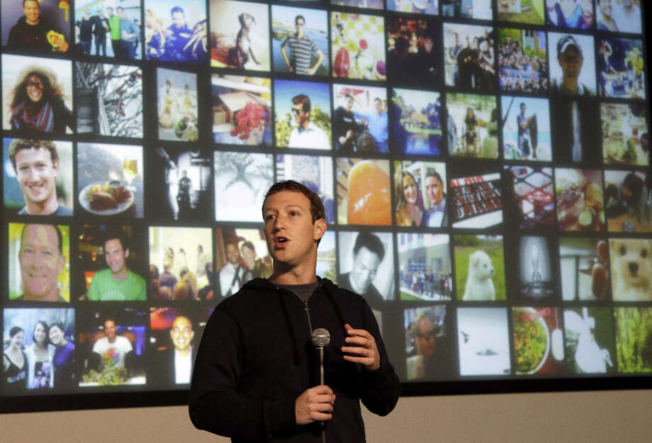 "Facebook CEO Mark Zuckerberg speaks at Facebook headquarters in Menlo Park, Calif., Tuesday, Jan. 15, 2013.  Zuckerberg introduced ""graph search Tuesday, a new service that lets users search their social connections for information about their friends' interests, and for photos and places.  (AP Photo/Jeff Chiu) Photo: Jeff Chiu, Associated Press / AP"