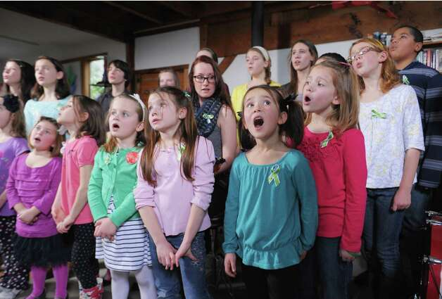 "FAIRFIELD, CT - JANUARY 14:  Children of Newton, CT perform ""A Song From Sandy Hook"" with Ingrid Michaelson (C) at the home of Chris Frantz and Tina Weymouth of the Talking Heads on January 14, 2013 in Fairfield, Connecticut.  (Photo by Michael Loccisano/Getty Images for Tim Hayes) Photo: Michael Loccisano, Getty Images For Tim Hayes / 2013 Getty Images"