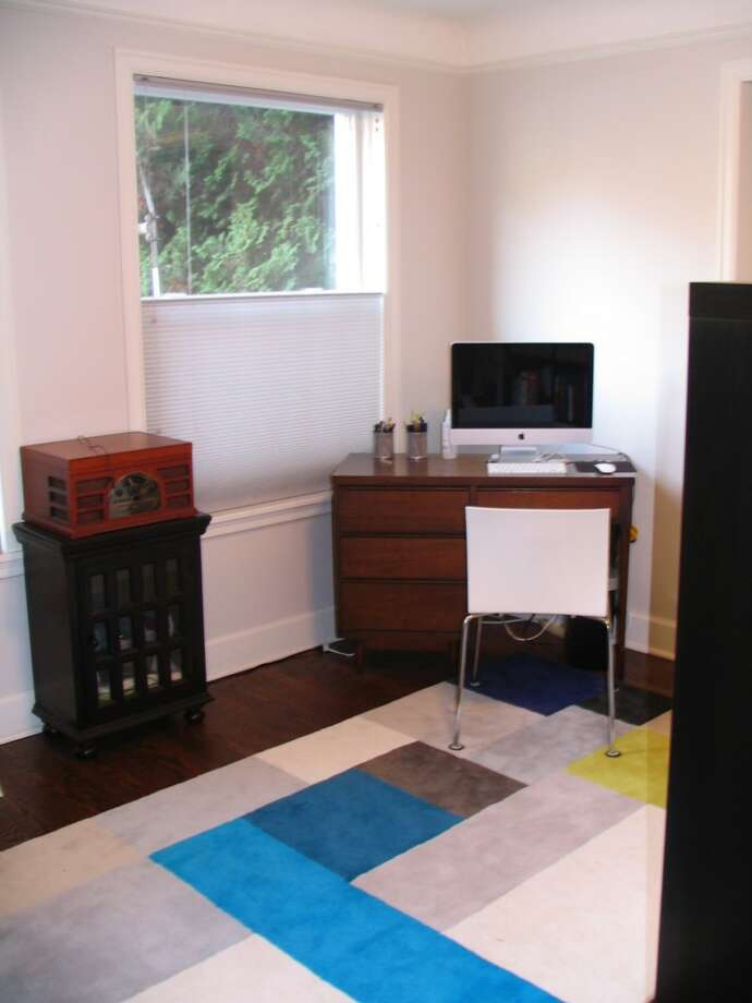 Living room office space of 325 Harvard Ave. E., No. 205. The 869-square-foot unit, in a 1928 building, has one bedroom, an updated bathroom and kitchen, and a washer and dryer. It's listed for $284,000. Photo: Courtesy Denise Seavitt/Village Homes & Properties