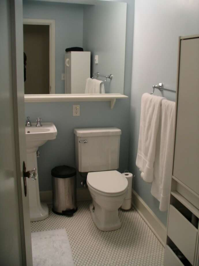 Bathroom of 325 Harvard Ave. E., No. 205. The 869-square-foot unit, in a 1928 building, has one bedroom, an updated kitchen, a living room with an office space, and a washer and dryer. It's listed for $284,000. Photo: Courtesy Denise Seavitt/Village Homes & Properties