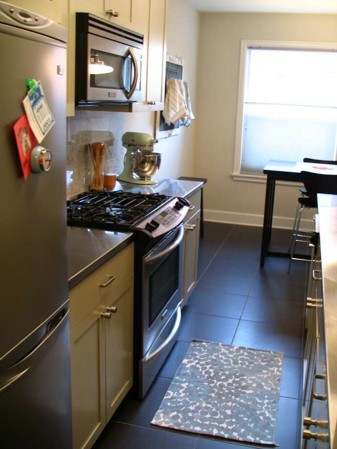 Kitchen of 325 Harvard Ave. E., No. 205. The 869-square-foot unit, in a 1928 building, has one bedroom, an updated bathroom, a living room with an office space, and a washer and dryer. It's listed for $284,000. Photo: Courtesy Denise Seavitt/Village Homes & Properties
