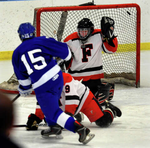 Fairfield Warde/Ludlowe goalie #1 Connor Frawley fails to stop a shot by Darien's #15 Craig Miller, during boys hockey action at the Wonderland of Ice in Bridgeport, Conn. on Saturday January 12, 2013. Photo: Christian Abraham / Connecticut Post