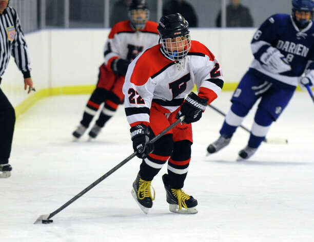 Fairfield Warde/Ludlowe's #22 Kyle Scheetz, during boys hockey action against Darien at the Wonderland of Ice in Bridgeport, Conn. on Saturday January 12, 2013. Photo: Christian Abraham / Connecticut Post
