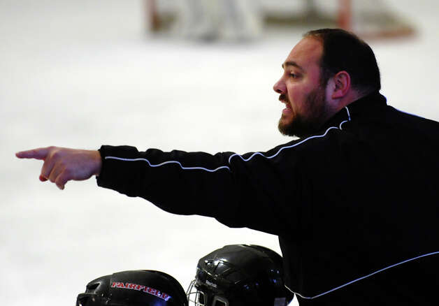 Fairfield Warde/Ludlowe Head Coach Mark Pettorini, during boys hockey action against Darien at the Wonderland of Ice in Bridgeport, Conn. on Saturday January 12, 2013. Photo: Christian Abraham / Connecticut Post