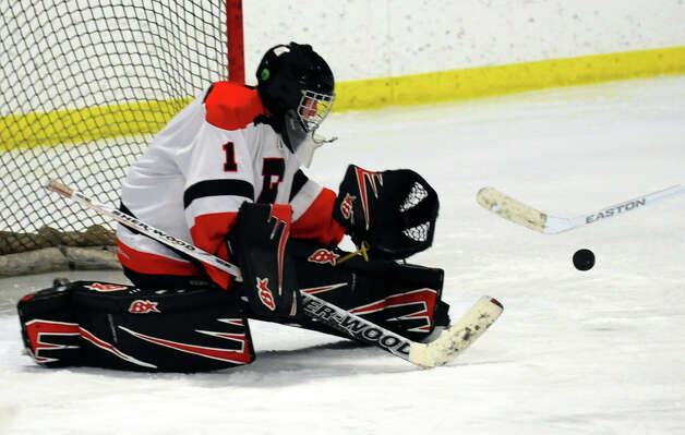 Fairfield Warde/Ludlowe goalie Connor Frawley deflects the puck, during boys hockey action against Darien at the Wonderland of Ice in Bridgeport, Conn. on Saturday January 12, 2013. Photo: Christian Abraham / Connecticut Post