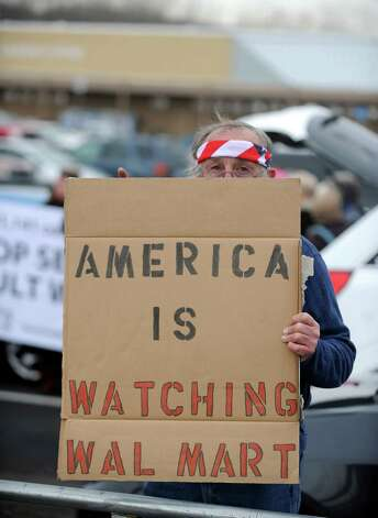 Joseph Barbarito, of Rifton, NY, holds a sign outside the Walmart in Danbury, Conn. Tuesday, Jan. 15, 2013 during a protest to deliver a petition signed by more than 250,000 Walmart customers and concerned citizens nationwide urging the retail giant to stop the sale of assault weapons and munitions. Photo: Autumn Driscoll / Connecticut Post