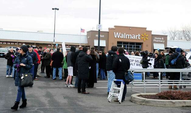 Protesters deliver a petition signed by more than 250,000 Walmart customers and concerned citizens nationwide urging the retail giant to stop the sale of assault weapons and munitions Tuesday, Jan. 15, 2013 at the Walmart in Danbury, Conn. Photo: Autumn Driscoll / Connecticut Post