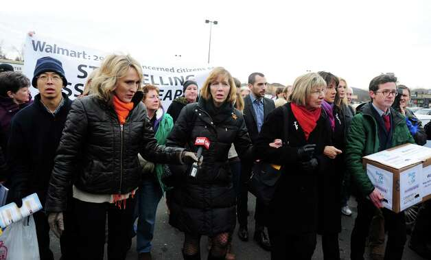 Protesters deliver a petition Tuesday, Jan. 15, 2013 signed by more than 250,000 Walmart customers and concerned citizens nationwide urging the retail giant to stop the sale of assault weapons and munitions at the Walmart in Danbury, Conn. Photo: Autumn Driscoll / Connecticut Post