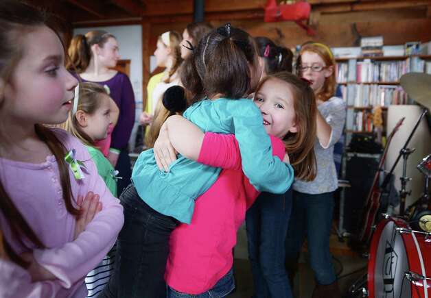 "Children of Newton, CT take a break from performing ""A Song From Sandy Hook"" with Ingrid Michaelson at the home of Chris Frantz and Tina Weymouth of the Talking Heads on January 14, 2013 in Fairfield, Connecticut. Photo: Michael Loccisano, (Photo By Michael Loccisano/Gett / 2013 Getty Images Connecticut Post contributed"