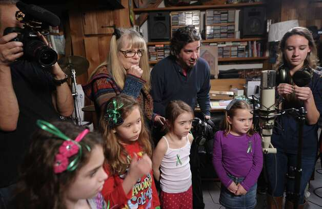 "Tina Weymouth (2nd L) of The Tom Tom Club and Talking Heads and Bruce Martin (2nd R) of The Tom Tom Club help children of Newton, CT perform ""A Song From Sandy Hook"" at her home on January 9, 2013 in Fairfield, Connecticut. Photo: Michael Loccisano, (Photo By Michael Loccisano/Gett / 2013 Getty Images Connecticut Post contributed"